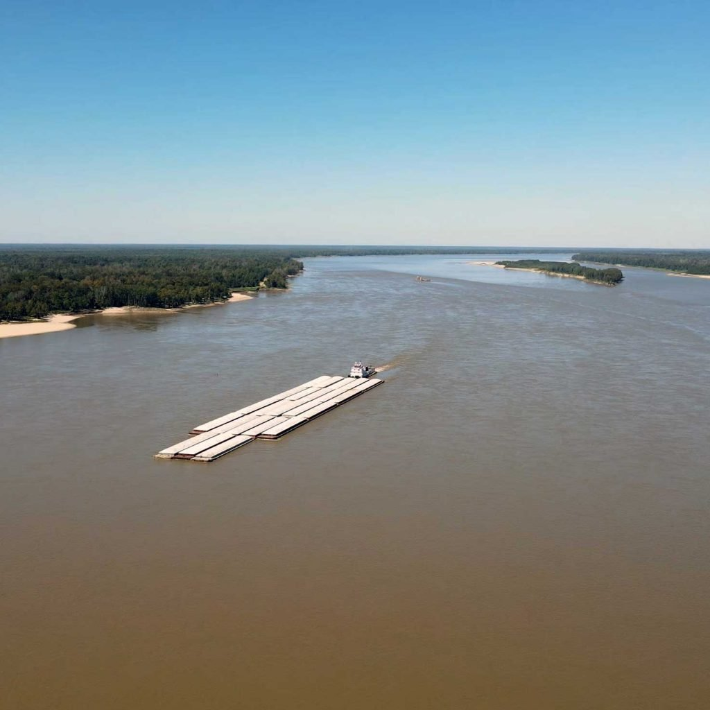 Barge floating down the Mississippi River